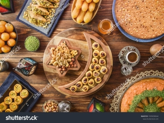 stock-photo-arabic-cuisine-middle-eastern-desserts-delicious-collection-of-ramadan-traditional-desserts-1935030044